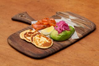 Housemade Smoked Salmon, Avocado, Pickled Onions, Silver Dollar Johnny Cakes